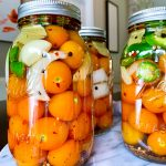 pickled cherry tomatoes with jalapeños in jars